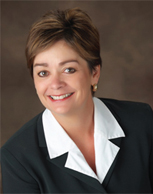 Headshot of Diane Nettifee, President and Founder of Magis
